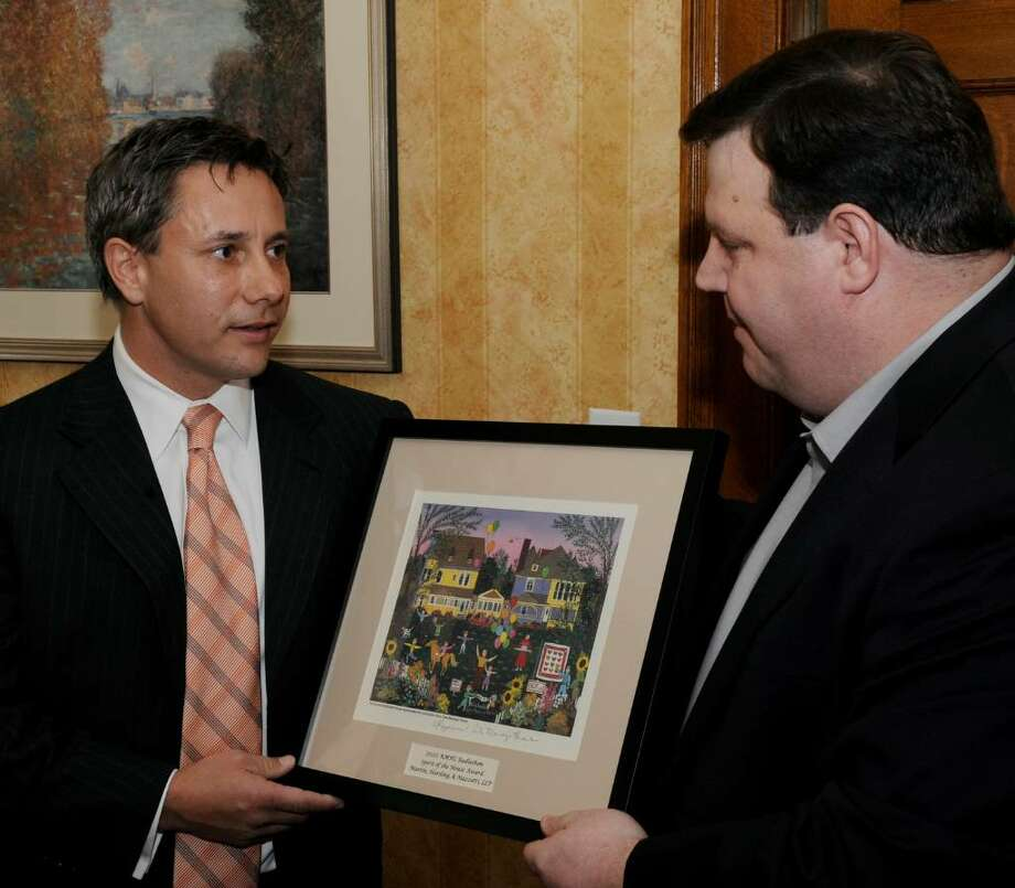 "Paul Harding, left, of Martin, Harding and Mazotti law firm receives the first ""Spirit of the House"" award from Jeff Yule, executive director of the Ronald McDonald House in Albany on Jan. 8.     (Skip Dickstein / Times Union) Photo: Skip Dickstein / 2008"