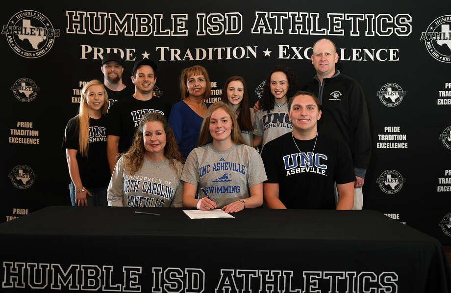 Alexis Baker, front center, of Kingwood Park High School, with her mom Loretta, front left, is all smiles after signing her letter of intent to swim for the University of North Carolina at Asheville during the Humble ISD Athletics Signing Day at The Overlook in Atascocita on Feb. 7, 2018. (Photo by Jerry Baker/Freelance) Photo: Jerry Baker, Freelance / Freelance