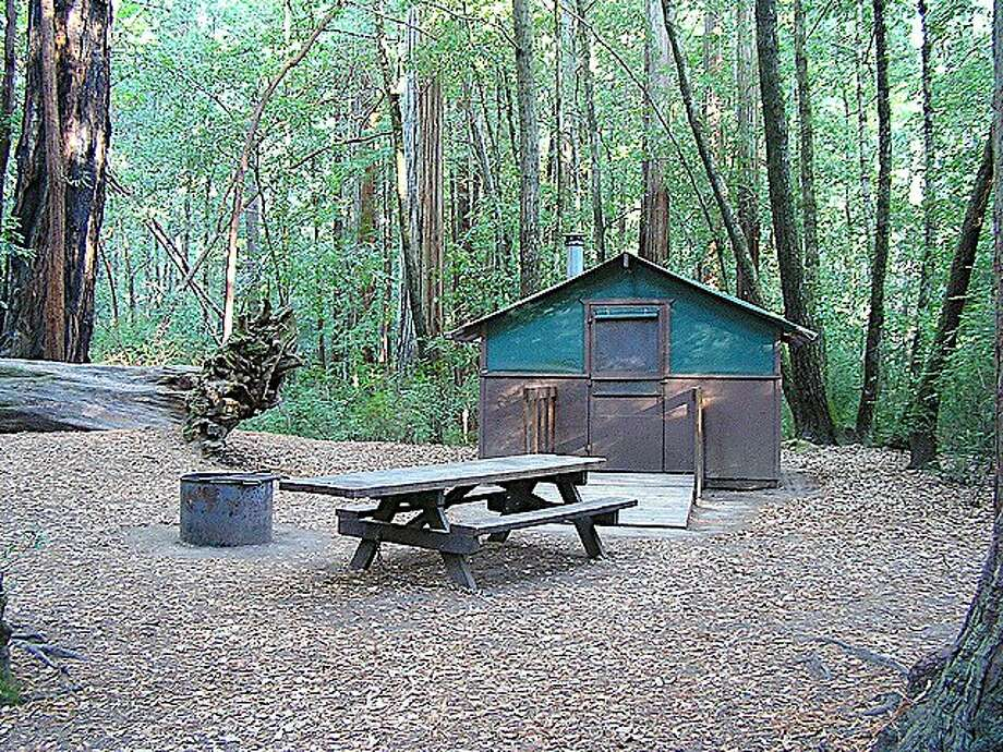 Big Basin Tent Cabins: A cool night and a warm cabin in the redwoods can transform your world overnight into a life of freedom, leisure and play. Photo: Tom Stienstra, Tom Stienstra / The Chronicle