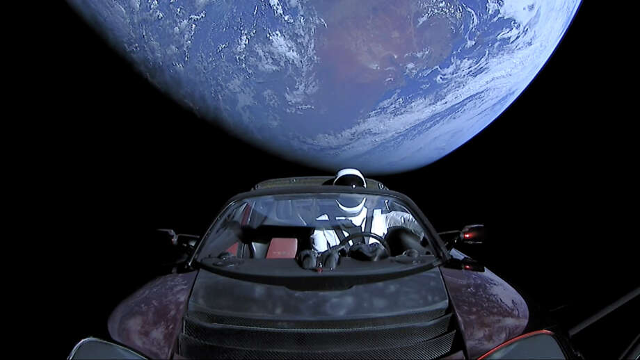 "IN SPACE - FEBRUARY 8: In this handout photo provided by SpaceX, a Tesla roadster launched from the Falcon Heavy rocket with a dummy driver named ""Starman""  heads towards Mars. Photo: Handout/Getty Images"