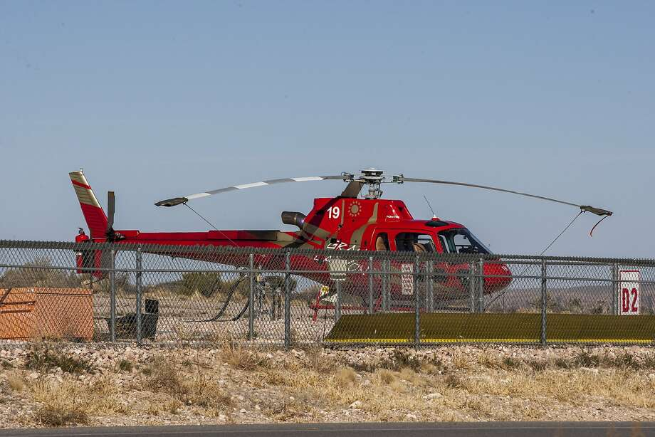 A helicopter belonging to Papillon Grand Canyon Helicopters rests on the tarmac at Grand Canyon West Airport near Peach Springs, Ariz. Photo: (Patrick Connolly/Las Vegas Review-Journal)