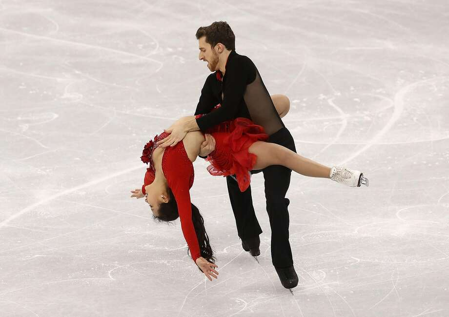 Yura Min and Alexander Gamelin of Korea compete during the Figure Skating  Team Event - Ice