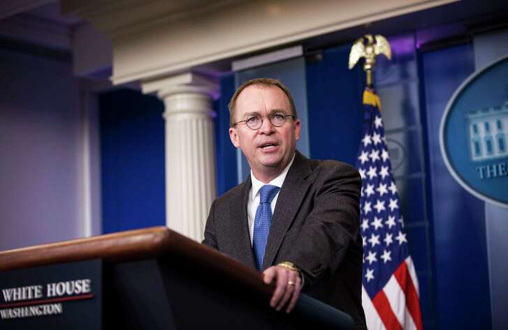 FILE é' Mick Mulvaney, the acting director of the Consumer Finance Protection Bureau, at the White House in Washington, Jan. 19, 2018. The Consumer Financial Protection Bureaué•s director can only be fired by the president for cause, a federal appeals court ruled on Jan. 31, restoring security to a job that has become a political lighting rod. (Al Drago/The New York Times)