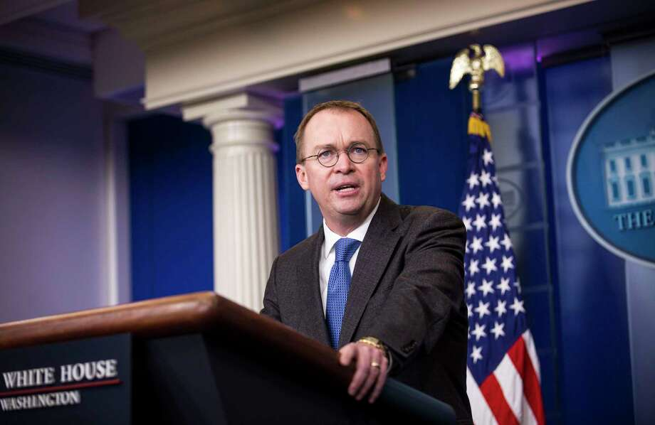 FILE é' Mick Mulvaney, the acting director of the Consumer Finance Protection Bureau, at the White House in Washington, Jan. 19, 2018. The Consumer Financial Protection Bureaué•s director can only be fired by the president for cause, a federal appeals court ruled on Jan. 31, restoring security to a job that has become a political lighting rod. (Al Drago/The New York Times) Photo: AL DRAGO, STR / NYTNS