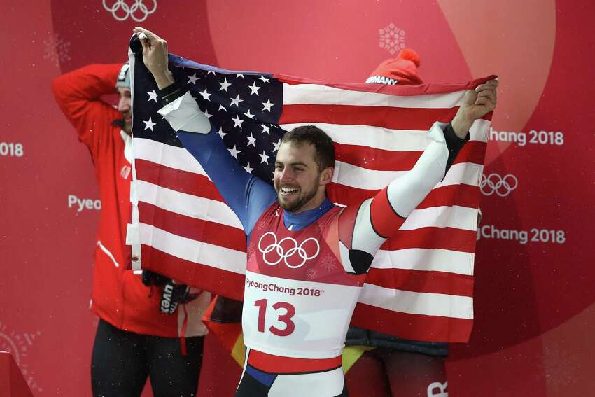 PYEONGCHANG-GUN, SOUTH KOREA - FEBRUARY 11: Chris Mazdzer of the United States celebrates after he won silver in the Luge Men's Singles on day two of the PyeongChang 2018 Winter Olympic Games at Olympic Sliding Centre on February 11, 2018 in Pyeongchang-gun, South Korea.