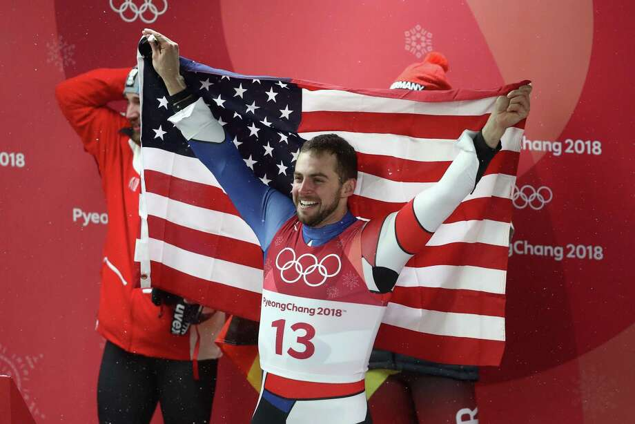 PYEONGCHANG-GUN, SOUTH KOREA - FEBRUARY 11:  Chris Mazdzer of the United States celebrates after he won silver in the Luge Men's Singles on day two of the PyeongChang 2018 Winter Olympic Games at Olympic Sliding Centre on February 11, 2018 in Pyeongchang-gun, South Korea. Photo: Ezra Shaw, Getty / 2018 Getty Images