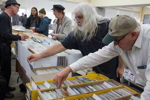 Larry Rosenbloom, right, and Rory Musil, center, look through music at the KUSF.org Rock 'N Swap Sunday, February 11, 2018  at University of San Francisco where record dealers and vendors came from all over to sell music, hard-to-find rarities and memorabilia.