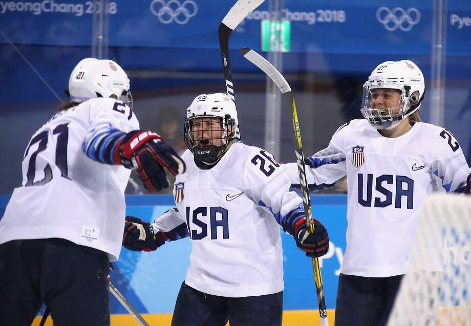 Kendall Coyne (center) celebrates after scoring the go-ahead goal against Finland in the Americans' Olympic opener. Photo: Bruce Bennett, Getty Images