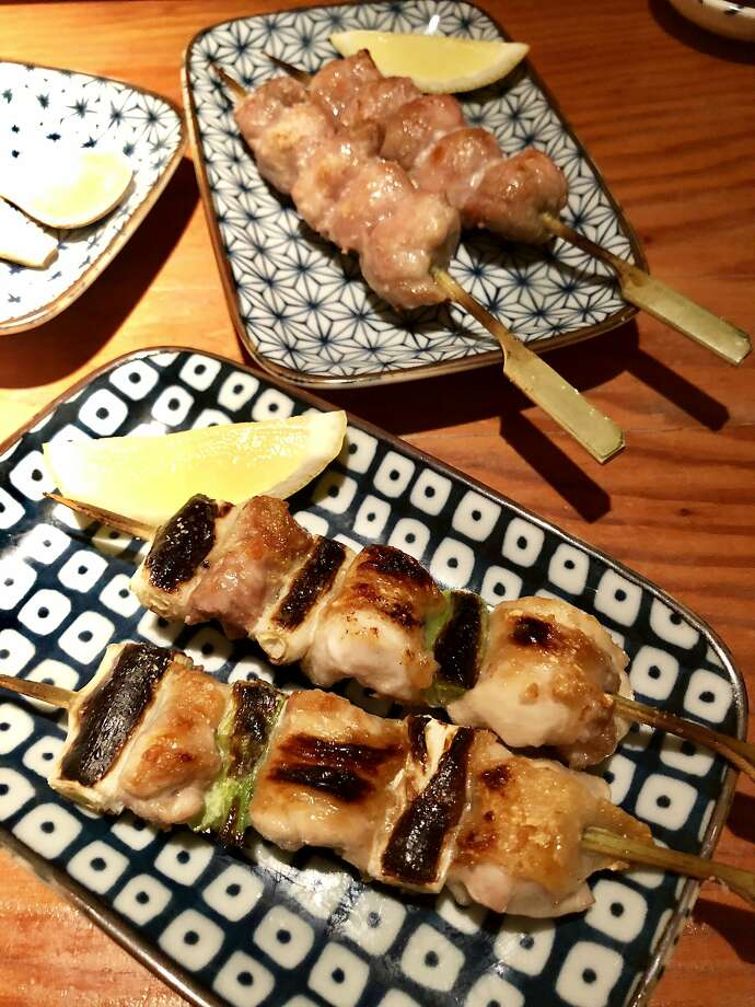 Chicken thigh (foreground) and chicken oyster at Miminashi. Photo: Michael Bauer, The Chronicle