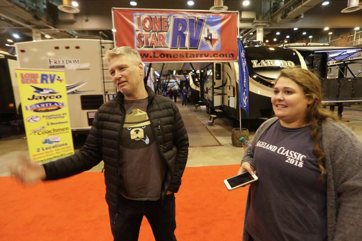 Chris Veum and his daughter Simone talk about being the only family still living in their neighborhood at the Houston RV Show Sunday, Feb. 11, 2018. Verum and his family have been living in an RV in their driveway since Hurricane Harvey hit. The Houston RV Show is now the largest in Texas with over 600 units on display. This includes Motorhomes, Travel Trailers, Tent Campers, Fifth Wheels, and Van Conversions. Recreational Vehicle related vendors representing campgrounds, resorts, parks and RV supplies.