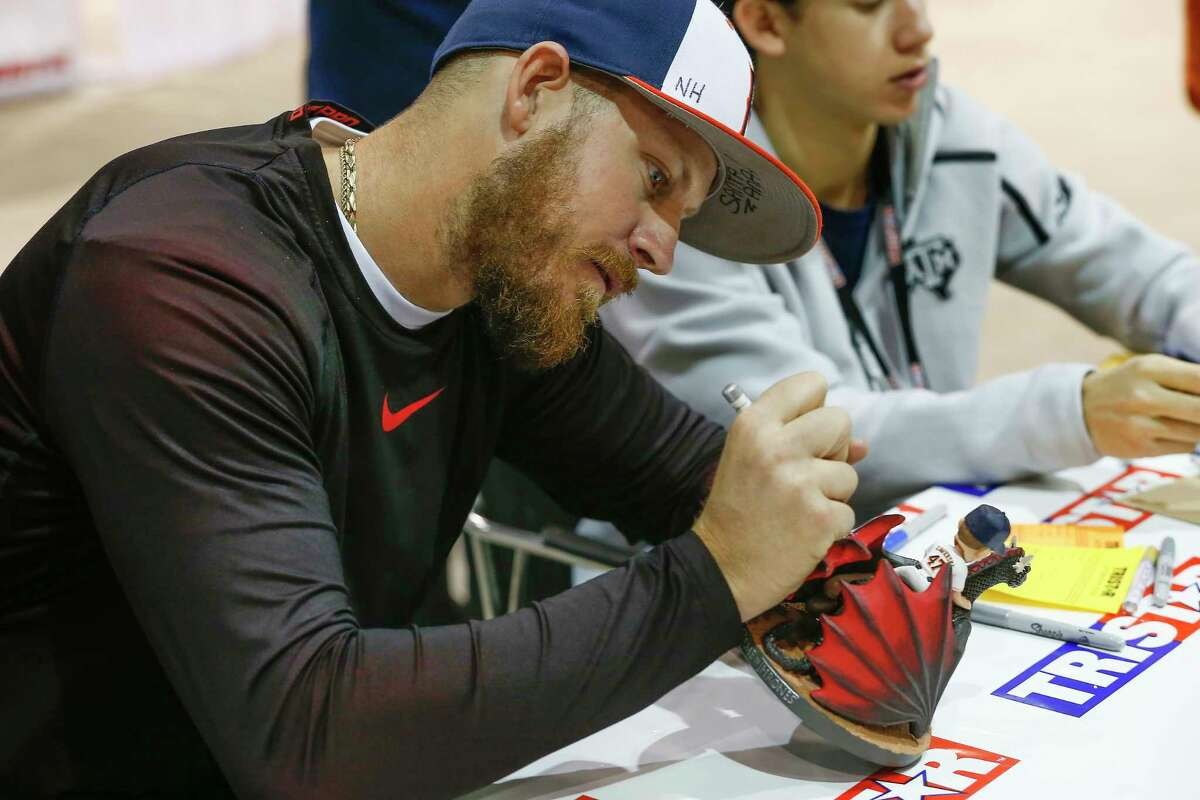 Chris Devenski signs autographs along current and former Astros players at the Houston Collectors Show in NRG Arena Sunday, Feb. 11, 2018, in Houston.