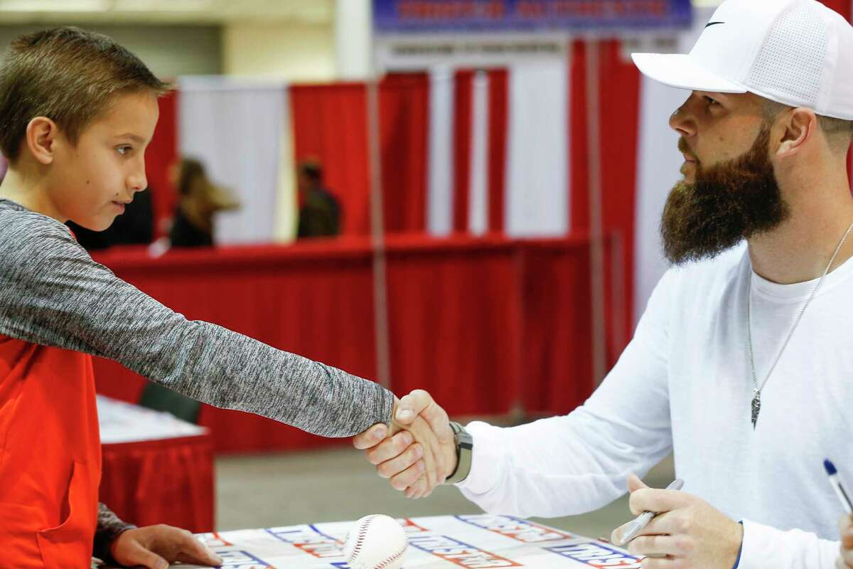 Grant Conner, 10, shakes hands with Dallas Keuchel at the Houston Collectors Show at the Houston Collectors Show in NRG Arena Sunday, Feb. 11, 2018, in Houston.