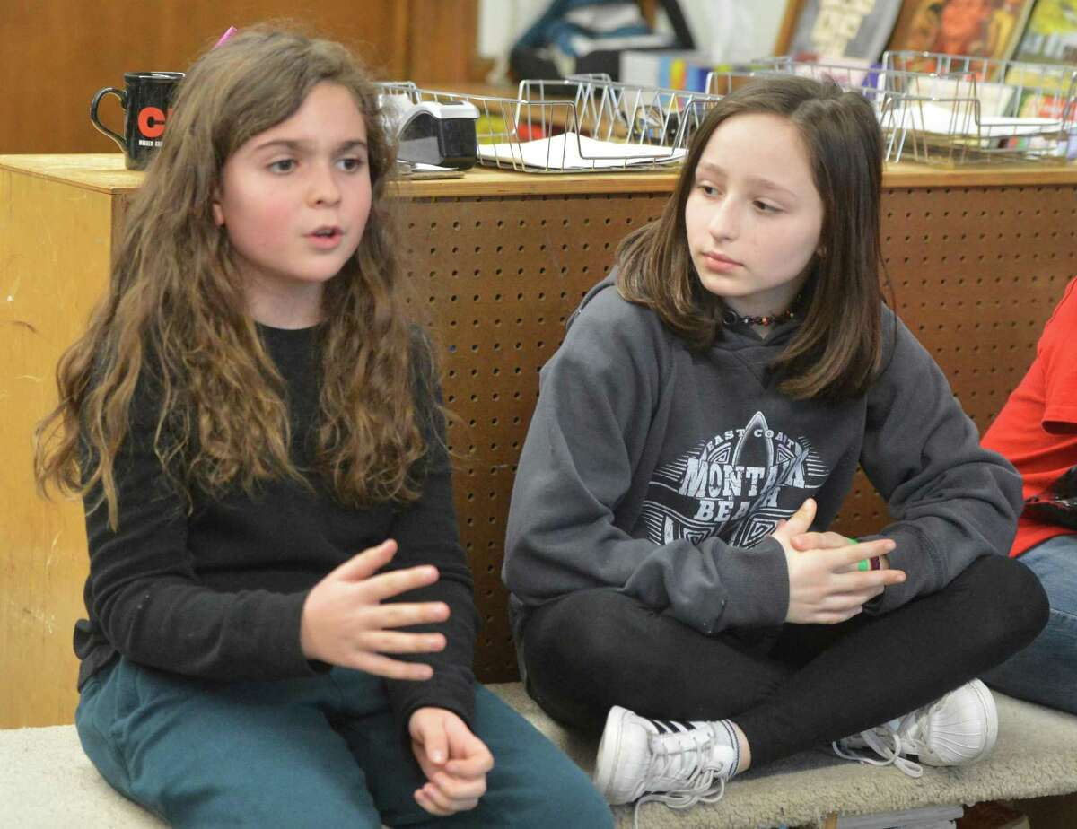 Laszlo Balazs and Elisabeth Mastrota talk about how their teacher Katy Ghadiyali and fifth grade students at Columbus Magnet School have worked to raise money and supplies for a classroom they adopted that was condemned after the hurricanes in the British Virgin Island of St. Croix on Wednesday in Norwalk.