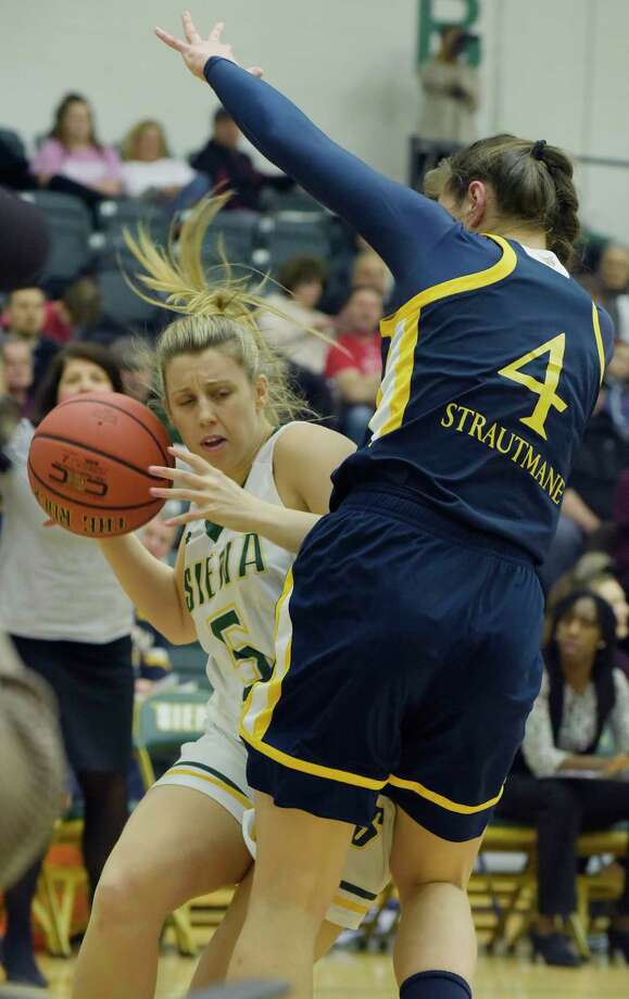 Hayley Winter of Siena, left, drives to the basket as Paula Strautmane of Quinnipiac defends during their game on Sunday, Feb. 11, 2018, in Loudonville, N.Y.    (Paul Buckowski/Times Union) Photo: PAUL BUCKOWSKI / (Paul Buckowski/Times Union)