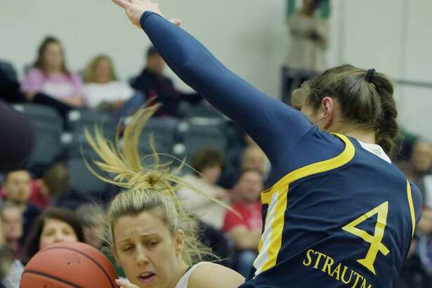 Hayley Winter of Siena, left, drives to the basket as Paula Strautmane of Quinnipiac defends during their game on Sunday, Feb. 11, 2018, in Loudonville, N.Y. (Paul Buckowski/Times Union)