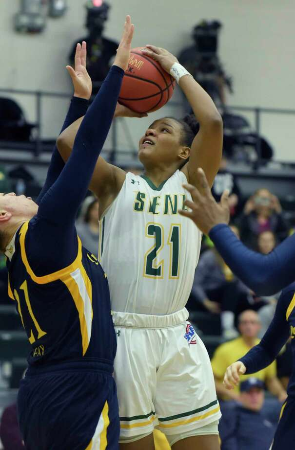 Kollyns Scarbrough of Siena puts up a shot over a Quinnipiac player during their game on Sunday, Feb. 11, 2018, in Loudonville, N.Y.    (Paul Buckowski/Times Union) Photo: PAUL BUCKOWSKI / (Paul Buckowski/Times Union)