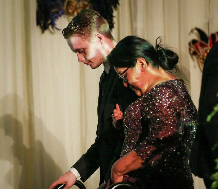Noah Vest and his CASA Advocate Rina French exit the stage during the CASA Speaks for Kids Annual Gala on Saturday, Feb. 10, 2018, at The Woodlands Waterway Marriott Hotel. Photo: Michael Minasi, Staff Photographer / © 2017 Houston Chronicle