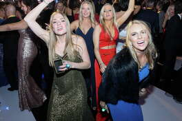 Danika Peterson, from left, Kelsie Brittan, Ashton Cabla and Rachel Kuenstler dance at the 2018 San Luis Salute at Galveston Convention Center on Friday, Feb. 9, 2018, in Galveston.