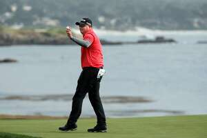 Ted Potter Jr. waves to the crowd as he celebrates as the winner of the 2018 AT&T Pebble Beach Pro-Am on the Pebble Beach Golf Links in Pebble Beach, Calif., seen on Sunday Feb. 11, 2018.
