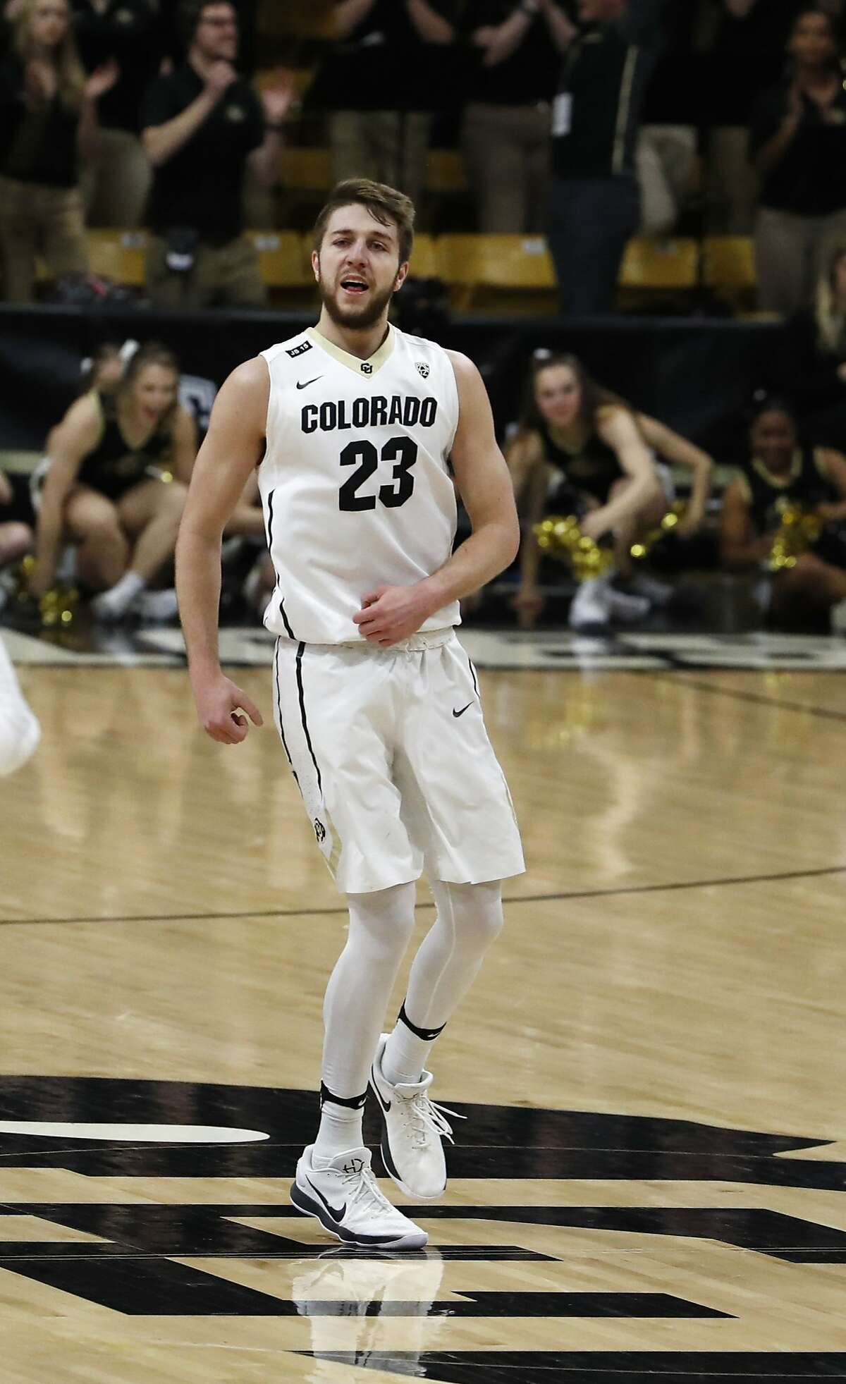 Colorado forward Lucas Siewert, back, smiles after hitting a three-point basket against Stanford late in the second half of an NCAA college basketball game Sunday, Feb. 11, 2018, in Boulder, Colo. (AP Photo/David Zalubowski)