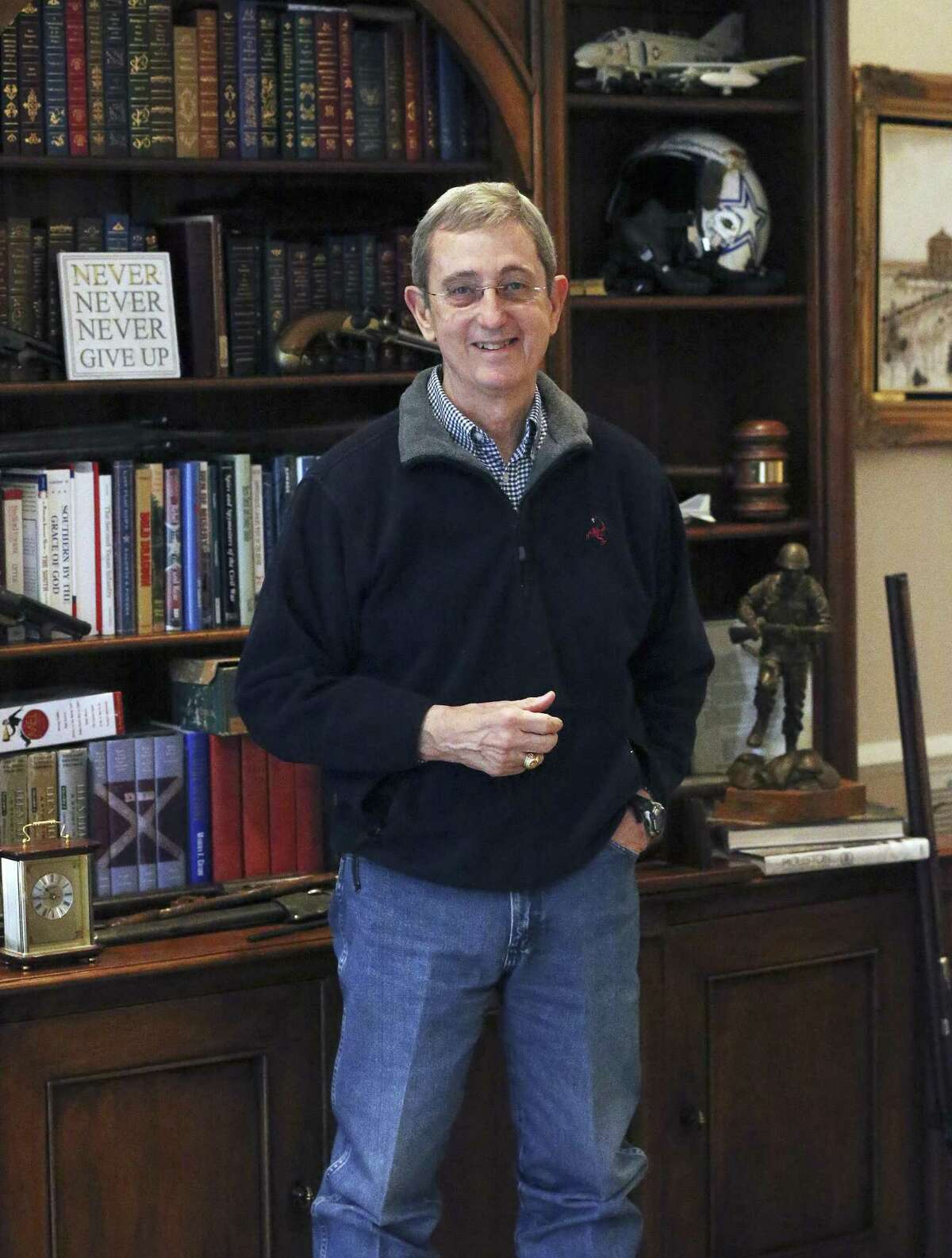 Jerry Patterson, candidate for Texas Land Commissioner, stands by a bookcase at his home in Austin on February 7, 2018.