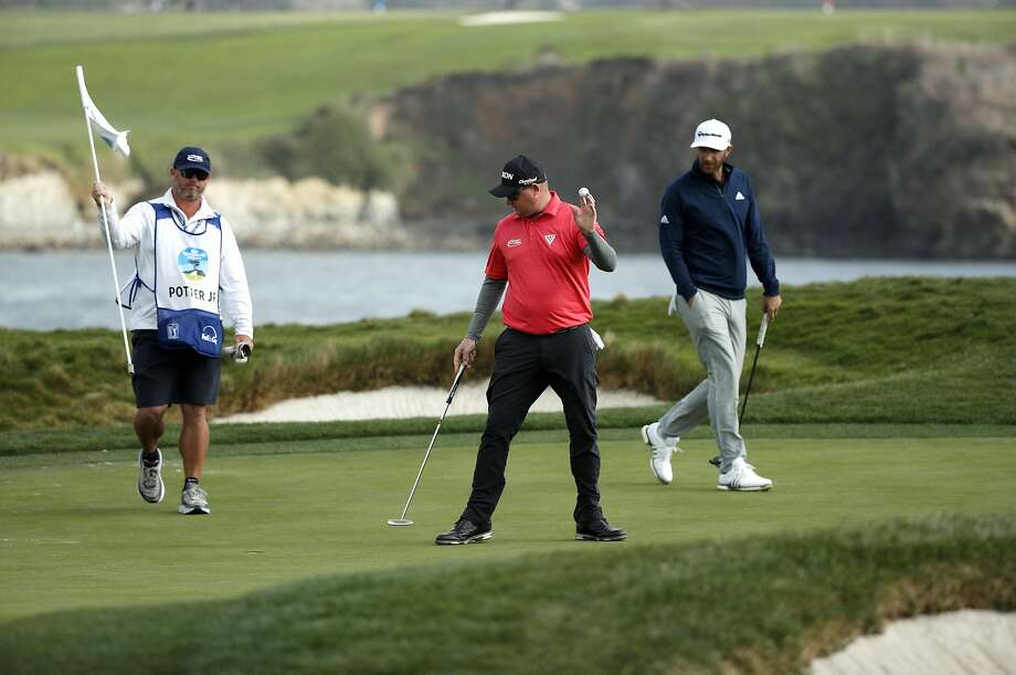 Ted Potter Jr. saved his par on the 17th hole and went on to win the AT&T Pebble Beach Pro-Am on the Pebble Beach Golf Links. Dustin Johnson, right, was in the final group also playing with Potter. Photo: Michael Macor, The Chronicle