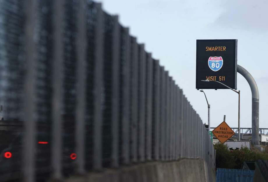 An electronic traffic message board is tested on eastbound Interstate 80 at the Powell Street off-ramp in Emeryville. Photo: Paul Chinn / The Chronicle / ONLINE_YES