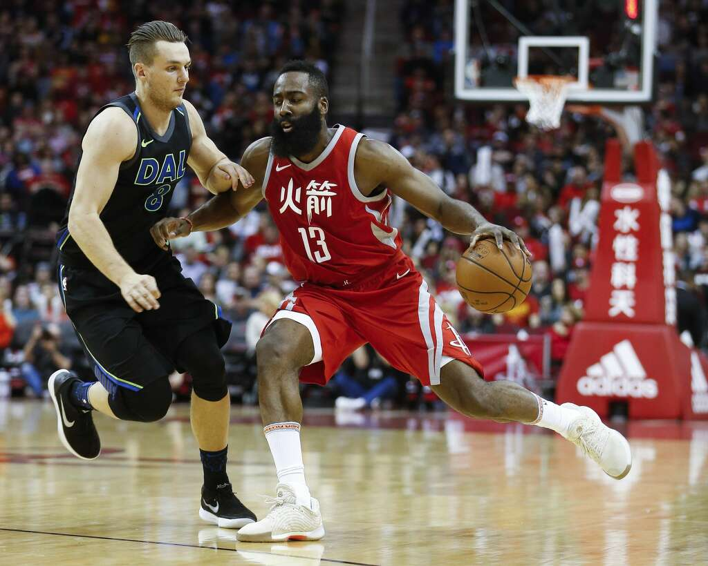 Houston Rockets guard James Harden (13) dribbles past Dallas Mavericks guard Kyle Collinsworth (8) as the Houston Rockets take on the Dallas Mavericks at the Toyota Center Sunday, Feb. 11, 2018 in Houston. (Michael Ciaglo / Houston Chronicle) Photo: Michael Ciaglo/Houston Chronicle