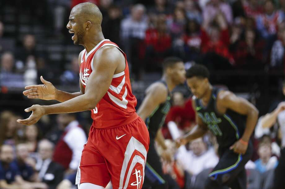 Houston Rockets guard Chris Paul (3) celebrates hitting a three-point shot as the Houston Rockets beat the Dallas Mavericks 104-97 at the Toyota Center Sunday, Feb. 11, 2018 in Houston. (Michael Ciaglo / Houston Chronicle) Photo: Michael Ciaglo/Houston Chronicle
