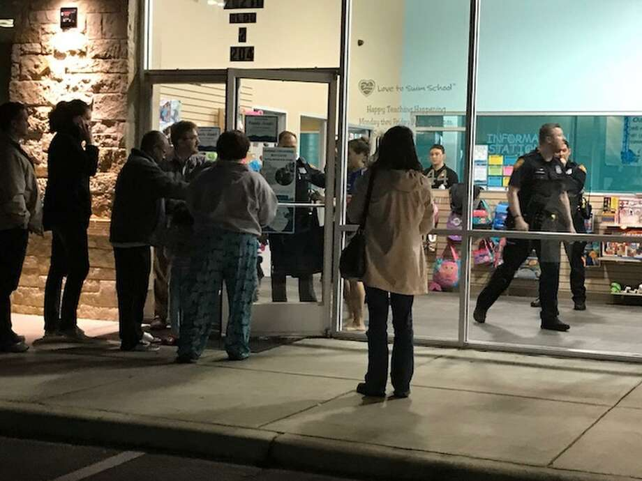 Parents wait outside the Love to Swim School on the north side Saturday night, Feb. 20, 2018, where police say a three-year-old boy was found unresponsive in the deep end of the pool by staff. The boy was rushed to North Central Baptist Hospital where he later died. Photo: Alexandro Luna, Staff / San Antonio Express-News / © 2018 San Antonio Express-News