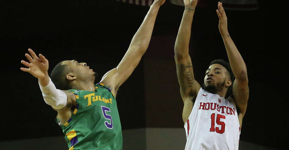 Houston Cougars forward Devin Davis (15) scores a three-pointer while Tulane Green Wave guard Cameron Reynolds (5) is trying to stop him during the first half of the AAC game at H&PE Arena Sunday, Feb. 11, 2018, in Houston.  ( Yi-Chin Lee / Houston Chronicle ) Photo: Yi-Chin Lee/Houston Chronicle