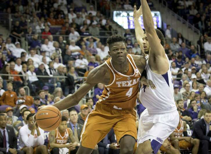 Texas's Mohamed Bamba (4) drives against TCU's Kenrich Williams in the Longhorns' loss to the Horned Frogs Saturday.