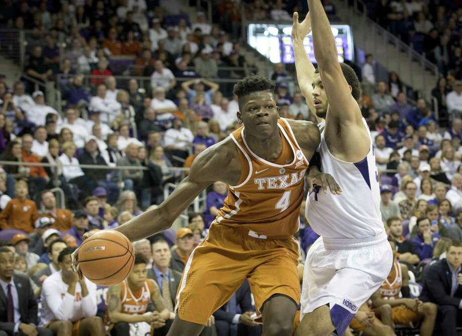 Texas's Mohamed Bamba (4) drives against TCU's Kenrich Williams in the Longhorns' loss to the Horned Frogs Saturday. Photo: Joyce Marshall /TNS / Fort Worth Star-Telegram