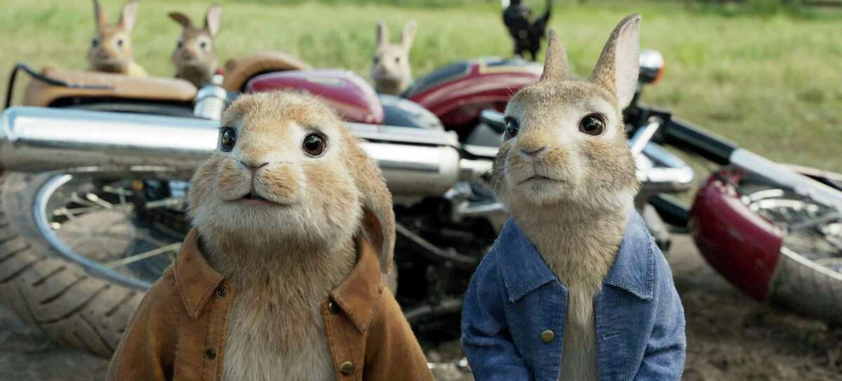 FILE - This filei mage released by Columbia Pictures shows characters Benjamin, voiced by Colin Moody, left, and Peter Rabbit, voiced by James Corden and Cottontail in a scene from