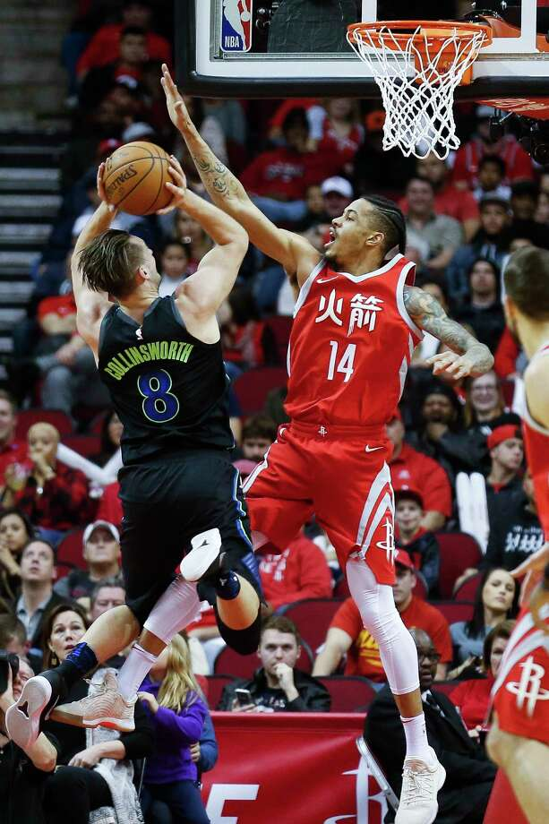 Rockets guard Gerald Green, right, does his best to deny Mavericks guard Kyle Collinsworth a clean look at the basket during Sunday night's clash at Toyota Center, Photo: Michael Ciaglo, Houston Chronicle / Michael Ciaglo