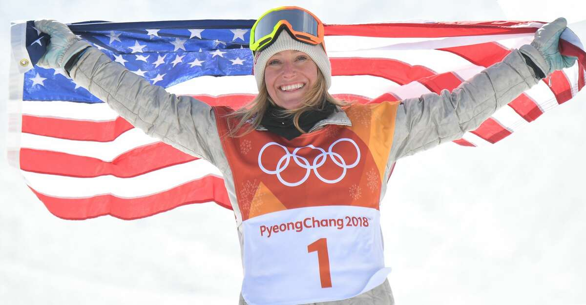 Gold medallist US Jamie Anderson celebrates during the victory ceremony after the women's snowboard slopestyle final event at the Phoenix Park during the Pyeongchang 2018 Winter Olympic Games on February 12, 2018 in Pyeongchang. / AFP PHOTO / LOIC VENANCELOIC VENANCE/AFP/Getty Images