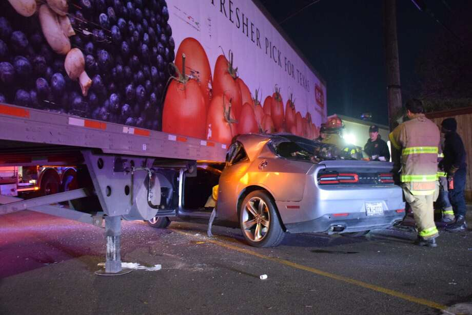 A man was hospitalized with serious injuries Monday morning after crashing into an H-E-B big rig. Photo: Caleb Downs / San Antonio Express-News