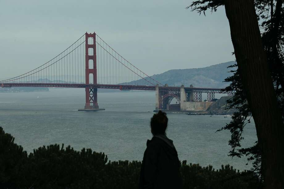 A women walks along Lincoln Highway at Lands End in San Francisco, Calif. Monday, Jan. 29, 2018. Cooler weather is on tap for the Bay Area this week as temperatures drop in some areas. Photo: Mason Trinca, Special To The Chronicle