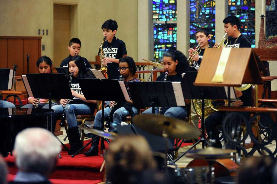 "Project Music musicians play during the ""Give Your Heart to Project Music"" benefit concert inside the First United Methodist Church on Cross Road in Stamford, Conn. on Sunday, Feb. 11, 2018. Project Music is a non-profit that provides access, opportunity and inspiration through free music lessons to inner-city Stamford youths. Photo: Michael Cummo / Hearst Connecticut Media / Stamford Advocate"