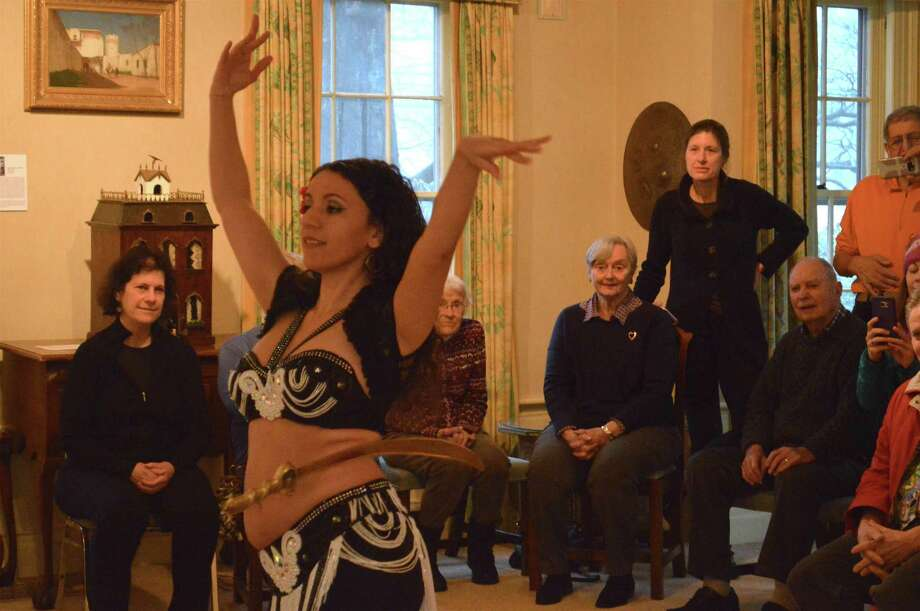"Students and observers watch instructor Tava Naiyin of Norwalk in action at the New Canaan Historical Society's ""The Art of Belly Dancing with Tava"" program on Sunday, Feb. 11, 2018, in New Canaan, Conn. Photo: Jarret Liotta / For Hearst Connecticut Media / New Canaan News Freelance"