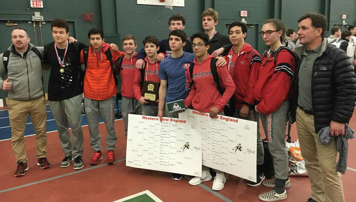 Members of the Greens Farms Academy wrestling team pose for a photo following completion of the Western New England Prep School wrestling championship meet at the Taft School in Waterford. The Dragons placed third in the meet with two New England champs, including Westport's Griffin Seyfried (center)