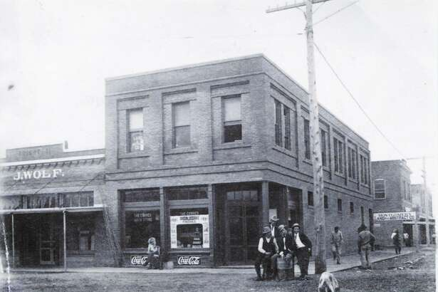 The Collier & Harris Building circa 1920 at Pacific and Simonton Street in downtown Conroe. The building was constructed by Dr. Collier and his partner G.M. Harris. Dr. Collier had his practice on the second floor and Harris ran a drug store on the bottom floor.