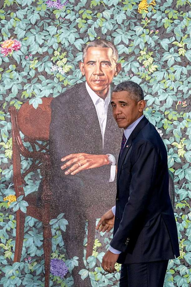 Former President Barack Obama stands in front of his official portrait by Artist Kehinde Wiley at its unveiling at the Smithsonian's National Portrait Gallery, Monday, Feb. 12, 2018, in Washington. Photo: Andrew Harnik, Associated Press