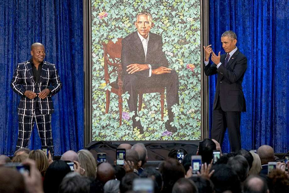 Former President Barack Obama, right, and Artist Kehinde Wiley, left, unveil Obama's official portrait at the Smithsonian's National Portrait Gallery, Monday, Feb. 12, 2018, in Washington. Photo: Andrew Harnik, Associated Press