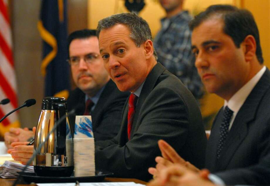 State Sen. Eric Schneiderman, center, chairs a committee to look into Democratic Sen. Hiram Monserrate, and his possible expulsion following his recent legal problems, in the Capitol in Albany on Monday evening. Sen. Andrew Lanza is at right, while Special Counsel Daniel Alonso is at left.  ( Philip Kamrass / Times Union) Photo: PHILIP KAMRASS