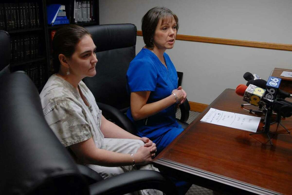 Albany Medical Center registered nurses, Kathryn Dupuis, left, and Lorna Patterson, right, discuss their opposition to the swine flu vaccine mandate, during a press conference at their lawyer's, Terence Kindlon, office on Monday, Oct. 12, 2009. (Paul Buckowski / Times Union)