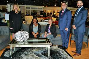 Debra A. Greenwood, President & CEO of The Center for Family Justice, meets with employees of Bob's Discount Furniture who assisted with the recent donation of $30,000 in furniture from the chain's charitable foundation. Cutline Information From left to right in second attached photo: Debra A. Greenwood, President & CEO of The Center for Family Justice, with Bob's employees Sales Associate Anasia Warren, Bridgeport Store Manager Judith Mansfield, Zone Vice President Nick Vassilakos and Regional Manager Adam Abbassi