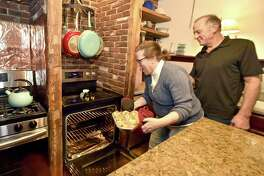 Stacie and Michael DiNello, owners and innkeepers of the Riverwind Inn in Deep River, a bed-and-breakfast, bake homemade blueberry muffins for guests.