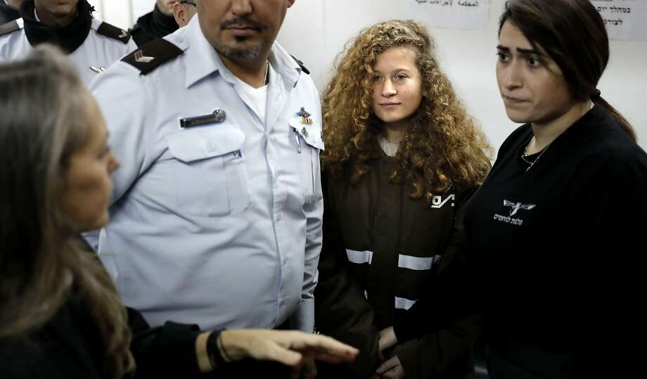 Seventeen-year-old Ahed Tamimi (center) is to go on trial before an Israeli military court on Tuesday for slapping and punching two Israeli soldiers. Photo: THOMAS COEX, AFP/Getty Images