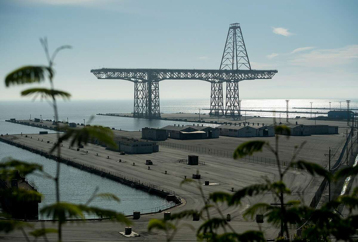 A crane stands at the former Hunters Point Naval Shipyard on Tuesday, Jan. 30, 2018, in San Francisco.